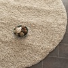 Safavieh California Shag Beige Round Indoor Machine-Made Area Rug (Common: 7 x 7; Actual: 79-in W x 79-in L x 0.58-ft Dia)